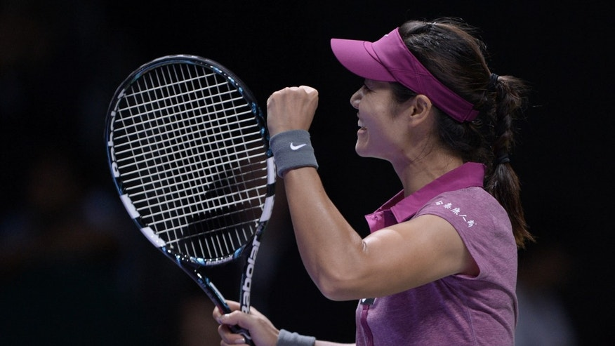 Li Na of China celebrates after she defeated Jelena Jankovic of Serbia during their tennis match at the WTA championship in Istanbul, Turkey, Thursday, Oct. 24, 2013. The world's top female tennis players compete in the championships which runs from Oct. 22 until Oct. 27. (AP Photo)