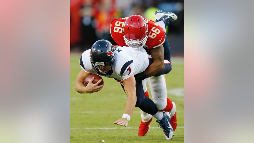 Houston Texans quarterback Case Keenum (7) is sacked by Kansas City Chiefs inside linebacker Derrick Johnson (56) during the second half of an NFL football game at Arrowhead Stadium in Kansas City, Mo., Sunday, Oct. 20, 2013. (AP Photo/Ed Zurga)