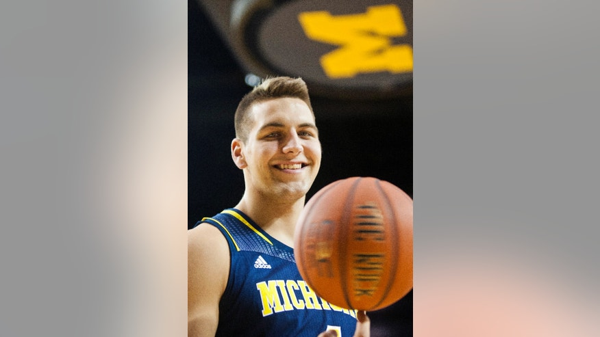 Michigan forward Mitch McGary poses for a portrait during an NCAA college basketball team's preseason media day Thursday, Oct. 24, 2013, at the Crisler Center in Ann Arbor, Mich. (AP Photo/Tony Ding)