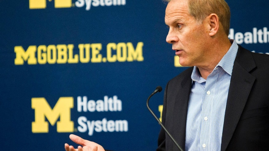 Michigan head coach John Beilein answers questions in a news conference during an NCAA college basketball team's preseason media day Thursday, Oct. 24, 2013, at the Crisler Center in Ann Arbor, Mich. (AP Photo/Tony Ding)