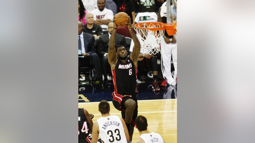 Miami Heat small forward LeBron James (6) drives to the basket against the New Orleans Pelicans in the first half of a preseason NBA basketball game in New Orleans, Wednesday, Oct. 23, 2013. (AP Photo/Bill Haber)