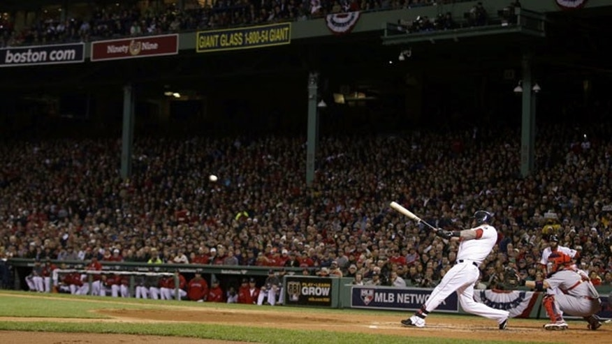 October 23, 2013: Boston's Mike Napoli hits a three-run double during the first inning of Game 1 of baseball's World Series against the St. Louis Cardinals in Boston. (AP Photo/Matt Slocum)