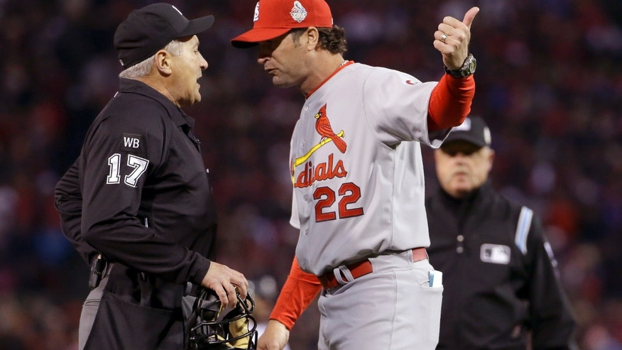 St. Louis Cardinals manager Mike Matheny argues a call with umpire John Hirschbeck during the first inning of Game 1 of baseball's World Series against the Boston Red Sox Wednesday, Oct. 23, 2013, in Boston. (AP Photo/Matt Slocum)