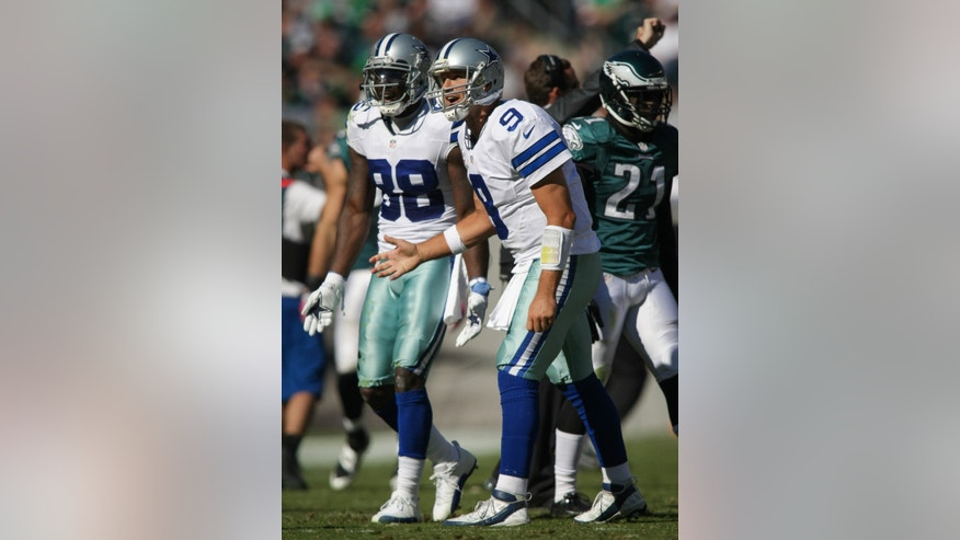 Cowboys quarterback Tony Romo, right, and Dez Bryant shout at the referee during an NFL football game against the Philadelphia Eagles on Sunday, Oct. 20, 2013, in Philadelphia. (AP Photo/The Wilmington News-Journal, Suchat Pederson)