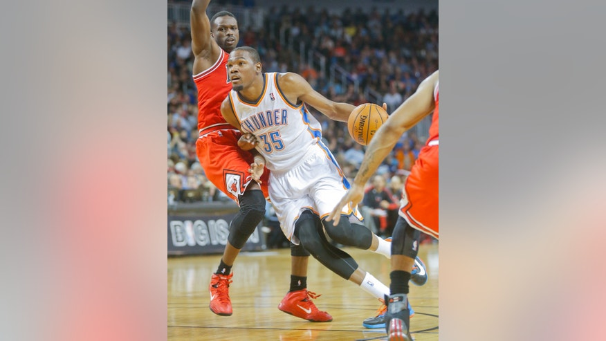 Oklahoma City Thunder's Kevin Durant (35) heads to the basket against the Chicago Bulls in the second quarter during their  preseason NBA basketball game in Wichita, Kan., Wednesday, Oct. 23, 2013. (AP Photo/The Wichita Eagle, Fernando Salazar) LOCAL TV OUT; MAGAZINES OUT; LOCAL RADIO OUT; LOCAL INTERNET OUT