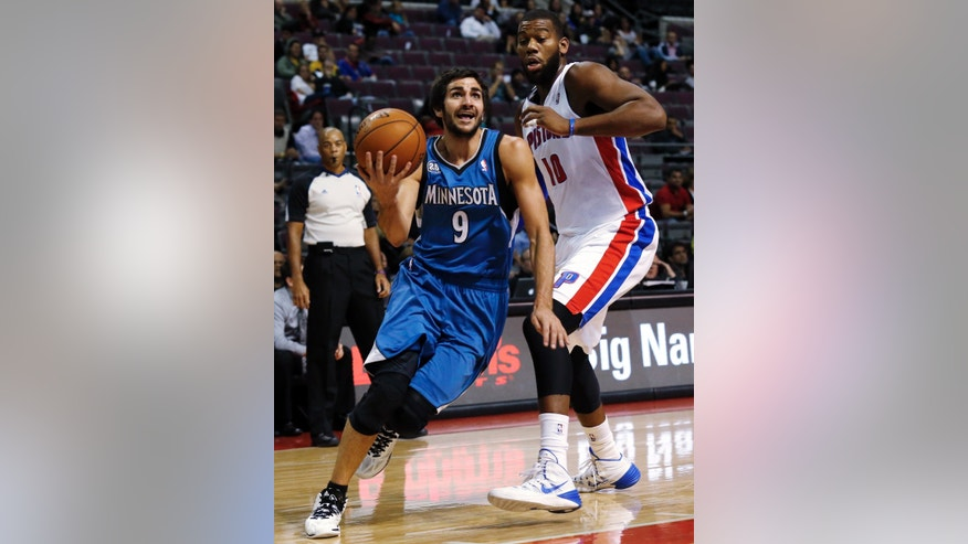 Minnesota Timberwolves point guard Ricky Rubio (9), of Spain, drives against Detroit Pistons center Greg Monroe (10) in the first half of their preseason NBA basketball game in Auburn Hills, Mich., Thursday, Oct. 24, 2013. (AP Photo/Paul Sancya)