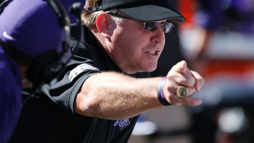 TCU head coach Gary Patterson talks to his team on the sidelines in the fourth quarter of an NCAA college football game against Oklahoma State in Stillwater, Okla., Saturday, Oct. 19, 2013. Oklahoma State won 24-10. (AP Photo/Sue Ogrocki)