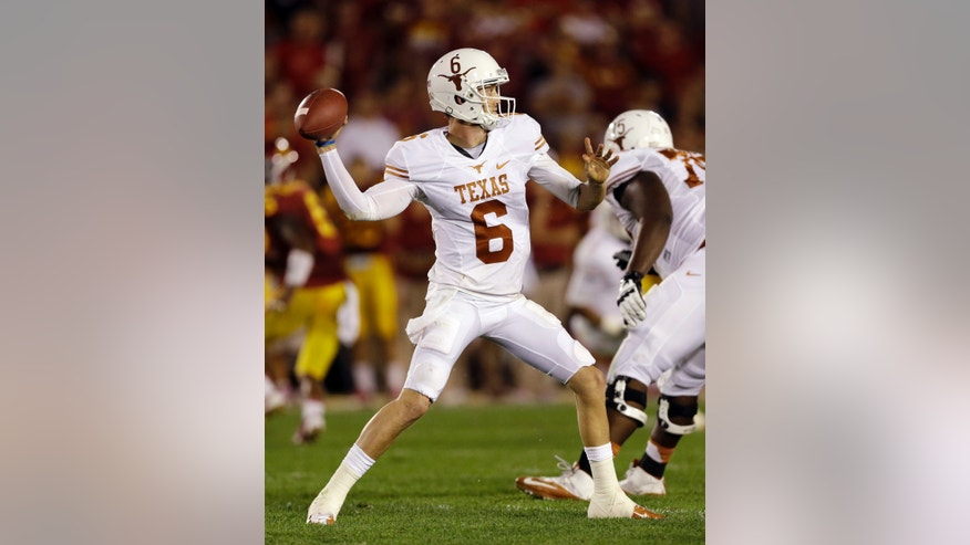 FILE - In this Oct. 3, 2013, file photo, Texas quarterback Case McCoy (6) looks to pass during the second half of an NCAA college football game against Iowa State in Ames, Iowa. McCoy carries himself with the swagger of a national championship-winning quarterback, not a career backup. It's that natural-born confidence that let him step in for injured David Ash and lead the Longhorns to three consecutive victories. (AP Photo/Charlie Neibergall, File)