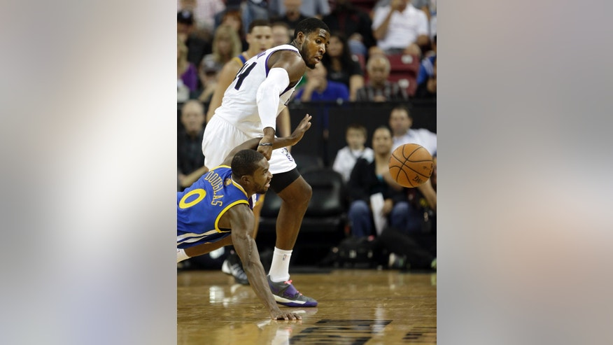 Golden State Warriors guard Toney Douglas, bottom, and Sacramento Kings forward Jason Thompson scramble after the ball during the first quarter of an NBA preseason basketball game in Sacramento, Calif., Wednesday, Oct. 23, 2013. (AP Photo/Rich Pedroncelli)