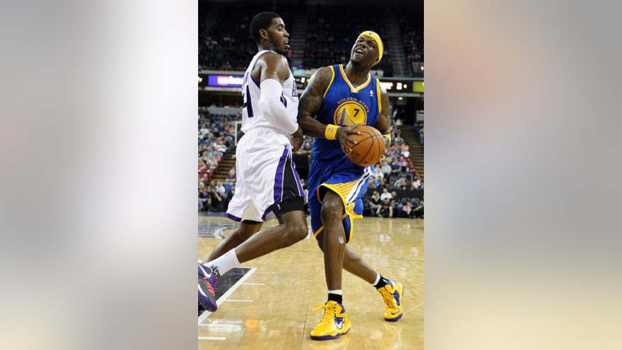 Golden State Warriors center Jermaine O'Neal, right, crashes into Sacramento Kings forward Jason Thompson during the second quarter of an NBA preseason basketball game in Sacramento, Calif., Wednesday, Oct. 23, 2013. (AP Photo/Rich Pedroncelli)