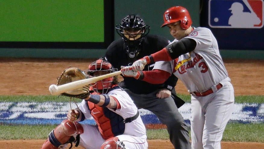 St. Louis Cardinals' Carlos Beltran hits an RBI single in front of Boston Red Sox catcher Jarrod Saltalamacchia during the seventh inning in Game 2 of baseball's World Series Thursday, Oct. 24, 2013, in Boston. (AP Photo/Charlie Riedel)