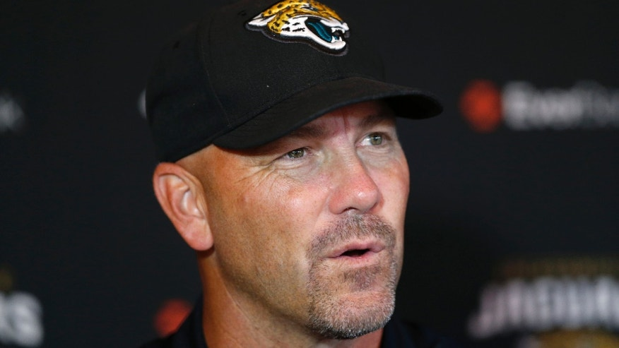 Jacksonville Jaguars' head coach Gus Bradley speaks to the media during a press conference at the Pennyhill Park Hotel and Spa in Bagshot, England, Wednesday, Oct. 23, 2013. Jaguars play San Francisco 49ers on Sunday in a NFL football game at Wembley Stadium in London. (AP Photo/Sang Tan)