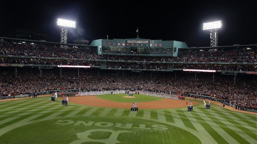 Players line up for the national anthem before Game 1 of baseball's World Series between the Boston Red Sox and the St. Louis Cardinals Wednesday, Oct. 23, 2013, at Fenway Park in Boston. (AP Photo/Charlie Riedel)