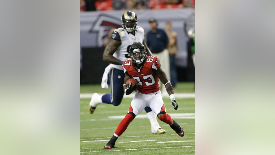 In this photo taken Sunday, Sept 15, 2013 Atlanta Falcons wide receiver Harry Douglas (83) runs down field against the St. Louis Rams during the first half of an NFL football game in Atlanta. Douglas, Drew Davis and Co. will need to come up big the rest of the season to help Atlanta cope with Julio Jones' season-ending injury and Roddy White's season-long ailments. It starts with Sunday's, Oct. 27, game at Arizona. (AP Photo/John Bazemore)