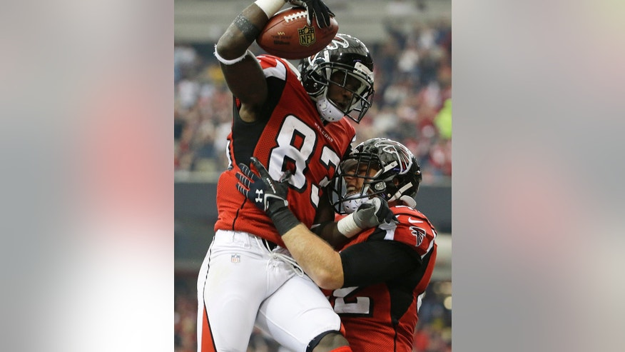 Atlanta Falcons fullback Patrick DiMarco (42) celebrates with Atlanta Falcons wide receiver Harry Douglas (83) after Douglas scored a touchdown against the Tampa Bay Buccaneers during the first half of an NFL football game, Sunday, Oct. 20, 2013, in Atlanta. (AP Photo/David Goldman)