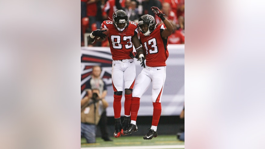 Atlanta Falcons wide receiver Harry Douglas (83) celebrates his touchdown with Darius Johnson (13), during the first half of an NFL football game, Sunday, Oct. 20, 2013, in Atlanta. (AP Photo/John Bazemore)