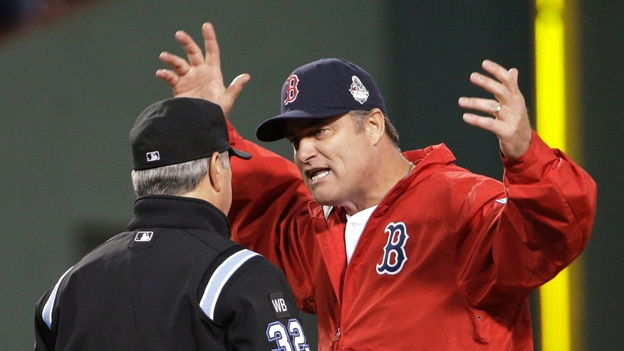 Boston Red Sox manager John Farrell argues a call with umpire Dana DeMuth during the first inning of Game 1 of baseball's World Series against the St. Louis Cardinals  Wednesday, Oct. 23, 2013, in Boston. (AP Photo/David J. Phillip)