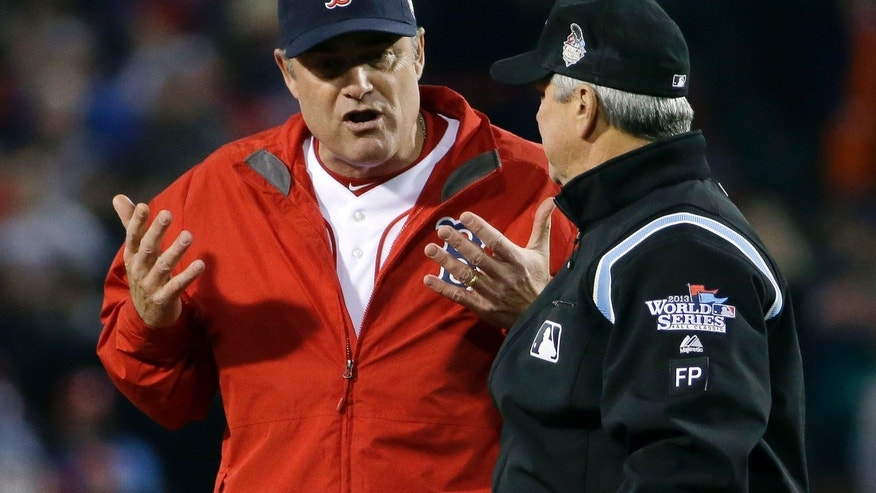 Boston Red Sox manager John Farrell argues a call with umpire Dana DeMuth during the first inning of Game 1 of baseball's World Series against the St. Louis Cardinals Wednesday, Oct. 23, 2013, in Boston. (AP Photo/Matt Slocum)