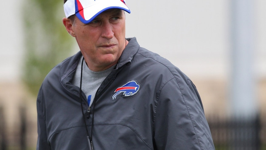 FILE - In this July 29, 2013 file photo, Buffalo Bills head coach Doug Marrone watches the action during their NFL football training camp in Pittsford, N.Y., Monday, July 29, 2013. Marrone credits Sean Payton for furthering his career by hiring him as an assistant in New Orleans in 2006. On Sunday, Oct. 27, the Bills travel to play the Saints in Marrone's first chance to face his mentor. (AP Photo/Bill Wippert, File)