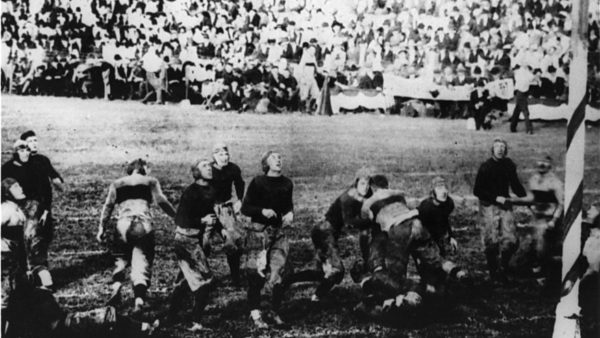 ADVANCE FOR WEEKEND EDITIONS, OCT. 26-27 - This Nov. 1, 1913, photo provided by the University of Notre Dame shows Notre Dame, in dark jerseys, during a football game against Army at West Point, N.Y.  The start of World War I was still months away and commercial radio broadcasts were several more years away when the Notre Dame football team boarded a train for West Point 100 years ago for a game against Army that not only brought the Fighting Irish into America's consciousness, but introduced fans to the promise of a fairly newfangled concept known as the forward pass.  (AP Photo/University of Notre Dame)