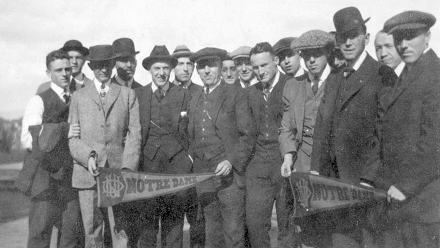 ADVANCE FOR WEEKEND EDITIONS OCT. 26-27 - This 1913 photo provided by the University of Notre Dame shows members of the Notre Dame football team in Kingston, N.Y., en route to West Point, N.Y., for a football game against Army. The start of World War I was still months away and commercial radio broadcasts were several more years away when the Notre Dame football team boarded a train for West Point 100 years ago for a game against Army that not only brought the Fighting Irish into America's consciousness, but introduced fans to the promise of a fairly newfangled concept known as the forward pass. (AP Photo/University of Notre Dame)
