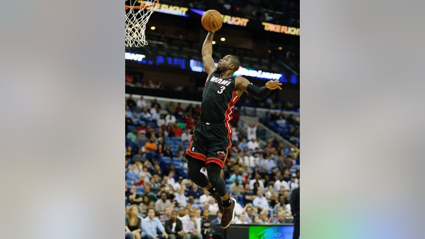 Miami Heat shooting guard Dwyane Wade (3) drives to the basket in the second half of a preseason NBA basketball game against the New Orleans Pelicans in New Orleans, Wednesday, Oct. 23, 2013.  The Heat defeated the Pelicans 108-95. (AP Photo/Bill Haber)