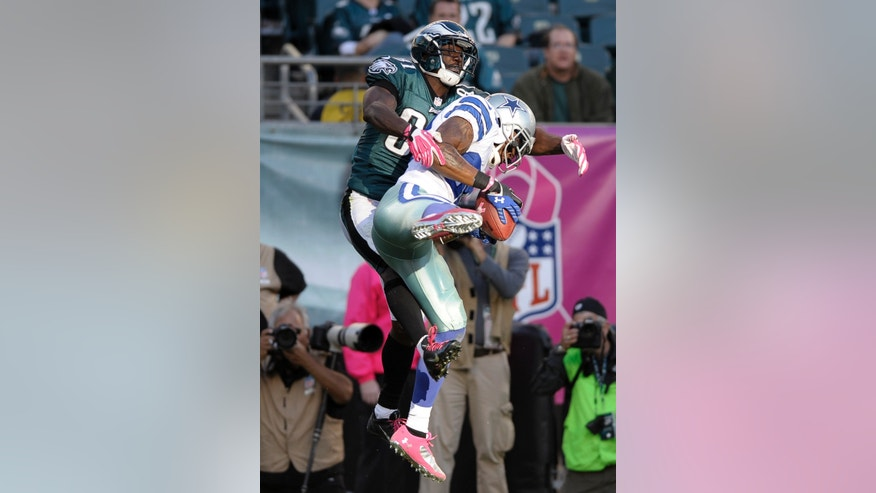 Dallas Cowboys cornerback Brandon Carr, right, intercepts a pass intended for Philadelphia Eagles wide receiver Jason Avant, left, from quarterback Matt Barkley during the second half of an NFL football game, Sunday, Oct. 20, 2013, in Philadelphia. (AP Photo/Michael Perez)