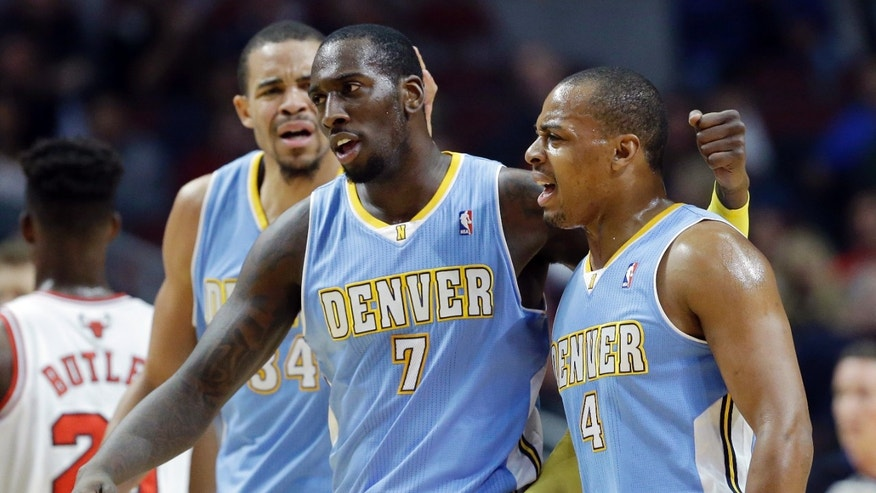 Denver Nuggets forward JJ Hickson (7) celebrates with guard Randy Foye (4) and center JaVale McGee after scoring a basket during the first half of an NBA preseason basketball game against the Chicago Bulls in Chicago on Friday, Oct. 25, 2013. (AP Photo/Nam Y. Huh)