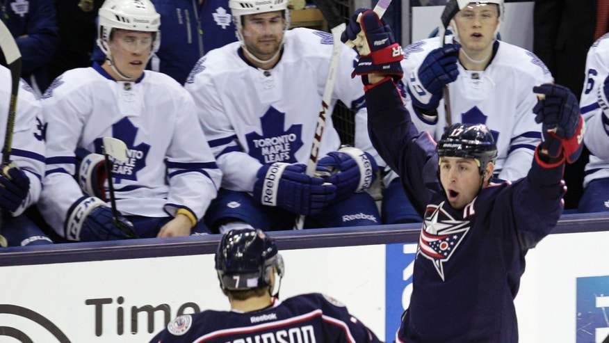 Columbus Blue Jackets' Brandon Dubinsky, right, celebrates his short-handed goal against the Toronto Maple Leafs with teammate Jack Johnson during the third period of an NHL hockey game on Friday, Oct. 25, 2013, in Columbus, Ohio. The Blue Jackets defeated the Maple Leafs 5-2. (AP Photo/Jay LaPrete)