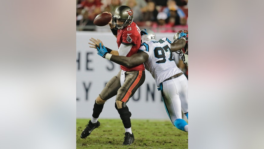 Tampa Bay Buccaneers quarterback Mike Glennon (8) is sacked by Carolina Panthers defensive end Mario Addison (97) during the fourth quarter of an NFL football game Thursday, Oct. 24, 2013, in Tampa, Fla. (AP Photo/Chris O'Meara)