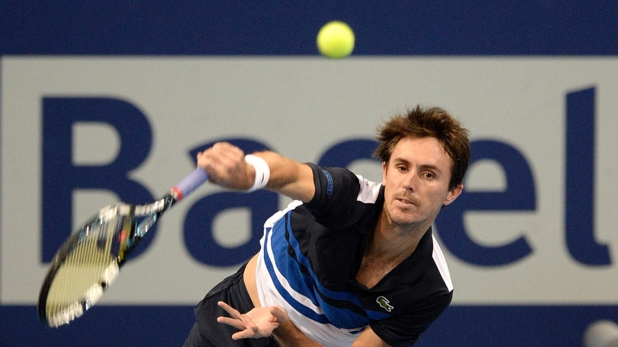 France's Edouard Roger-Vasselin serves a ball to Germany's Daniel Brands during their quarter final match at the Swiss Indoors tennis tournament at the St. Jakobshalle in Basel, Switzerland, on Friday, Oct. 25, 2013. (AP Photo/Keystone, Georgios Kefalas)
