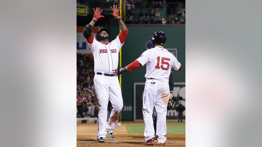 Boston Red Sox's Dustin Pedroia (15) congratulates David Ortiz after Ortiz's two-run home run during the sixth inning of Game 2 of baseball's World Series against the St. Louis Cardinals Thursday, Oct. 24, 2013, in Boston.  (AP Photo/Matt Slocum)