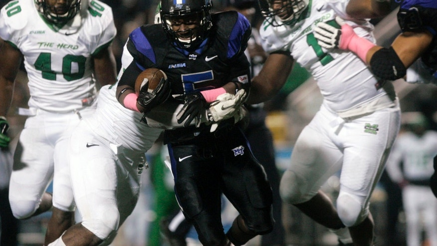 Middle Tennessee running back Jeremiah Bryson, center, rushes against Marshall in the second quarter of a college football game in Murfreesboro, Tenn., Thursday, Oct. 24, 2013. (AP Photo/The Daily News Journal, John A. Gillis)
