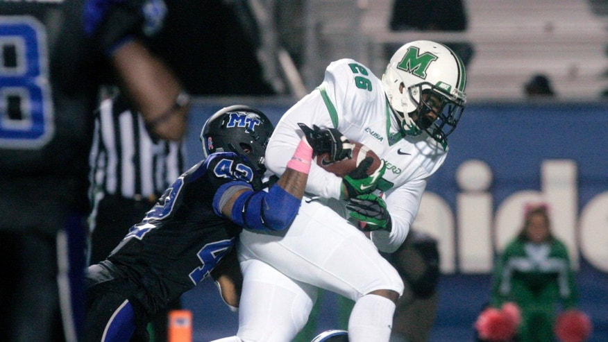 Marshall's Gator Hoskins, right, is tackled by Middle Tennessee safety Xavier Walker, left, near the goal line in the second quarter of a college football game in Murfreesboro, Thursday, Oct. 24, 2013. (AP Photo/The Daily News Journal, John A. Gillis)