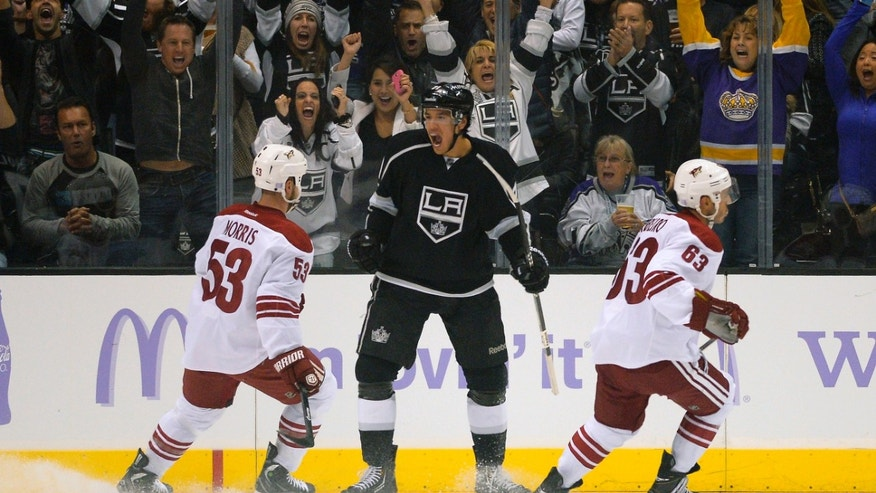 Los Angeles Kings center Jordan Nolan, center, celebrates his goal as Phoenix Coyotes defenseman Derek Morris, left, and center Mike Ribeiro look on during the first period of their NHL hockey game on Thursday, Oct. 24, 2013, in Los Angeles. (AP Photo/Mark J. Terrill)