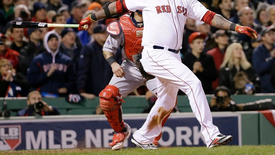 Boston Red Sox's David Ortiz hits a two-run home run during the sixth inning of Game 2 of baseball's World Series against the St. Louis Cardinals Thursday, Oct. 24, 2013, in Boston. (AP Photo/David J. Phillip)