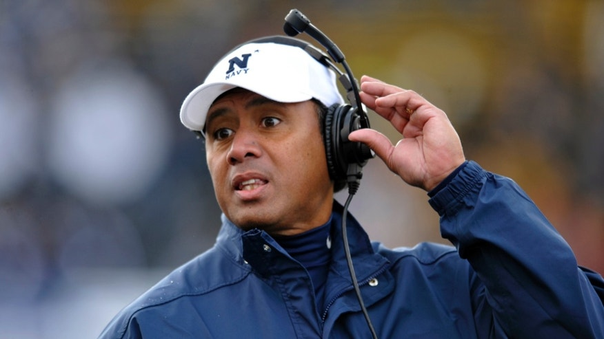 Navy head coach Ken Niumatalolo watches during the fourth quarter of an NCAA college football game against Toledo in Toledo, Ohio, Saturday, Oct. 19, 2013. (AP Photo/David Richard)