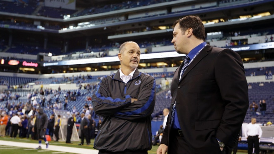 ADVANCE FOR WEEKEND EDITIONS, OCT. 26-27 - FILE - In this Dec. 20, 2012, file photo, Indianapolis Colts head coach Chuck Pagano, left, talks to general manager Ryan Grigson before an NFL football game against the Houston Texans in Indianapolis. In the 19 months since Peyton Manning was released, all the Colts general manager and coach have done is turn an abysmal 2-14 team into a division leader and a legitimate, long-term title contender. (AP Photo/Michael Conroy, File)