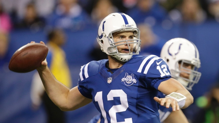 Indianapolis Colts quarterback Andrew Luck (12) throws a pass during the second half of an NFL football game against the Denver Broncos, Sunday, Oct. 20, 2013, in Indianapolis. (AP Photo/AJ Mast)
