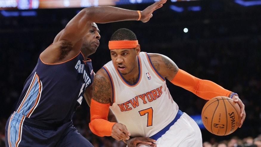 New York Knicks' Carmelo Anthony (7) drives past Charlotte Bobcats' Anthony Tolliver (43) during the first half of an NBA basketball game on Friday, Oct. 25, 2013, in New York. (AP Photo/Frank Franklin II)