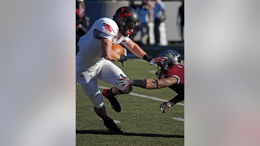 Eastern Washington wide receiver Cooper Kopp (10) dodges Montana cornerback Nate Harris (11) on his way to a second quarter touchdown in an NCAA college football game in Missoula, Mont., Saturday, Oct. 26, 2013. (AP Photo/Michael Albans)