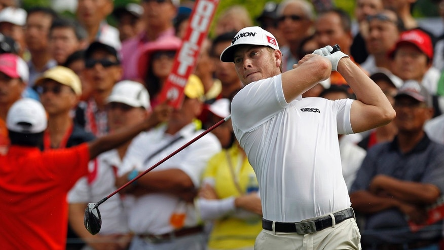 Chris Stroud of the U.S. tees off on the first hole during the third round of the CIMB Classic golf tournament at the Kuala Lumpur Golf and Country Club in Kuala Lumpur, Malaysia, Saturday, Oct. 26, 2013. (AP Photo/Lai Seng Sin)