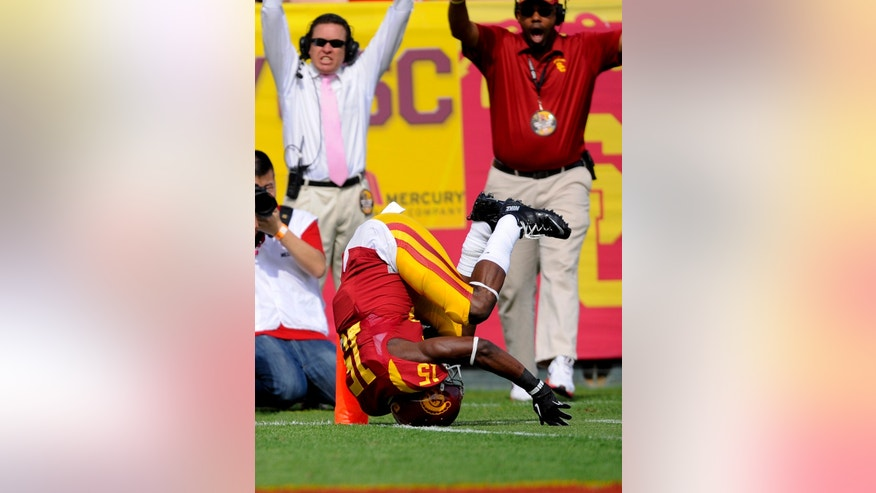 Southern California wide receiver Nelson Agholor dives for a touchdown during the first half of an NCAA college football game against Utah, Saturday, Oct. 26, 2013, in Los Angeles. (AP Photo/Gus Ruelas)