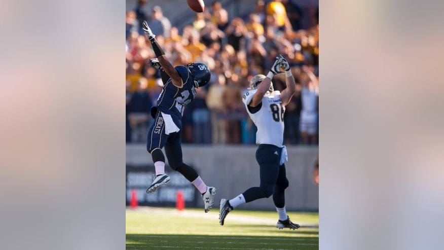 In this photo provided by Montana State University, Montana State safety James Nelson, left, disrupts a reception-attempt by UC Davis tight end Taylor Sloat (86) in the first half of an NCAA college football game on Saturday, Oct. 26, 2013, in Bozeman, Mont. (AP Photo/Montana State University, Kelly Gorham)