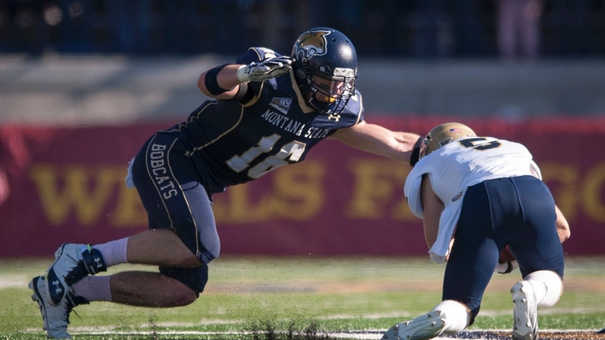 In this photo provided by Montana State University, Montana State linebacker Cole Moore (16) dives for UC Davis wide receiver Tom Hemmingsen, (5) in the first half of an NCAA college football game on Saturday, Oct. 26, 2013, in Bozeman, Mont. (AP Photo/Montana State University, Kelly Gorham)