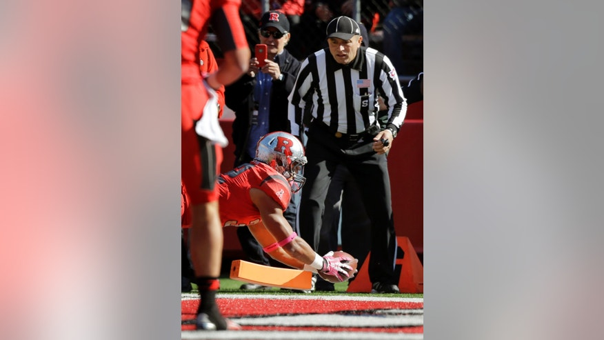 Rutgers running back Justin Goodwin (32) dives in for a touchdown during the first half of an NCAA college football game against Houston, Saturday, Oct. 26, 2013, in Piscataway, N.J. (AP Photo/Mel Evans)