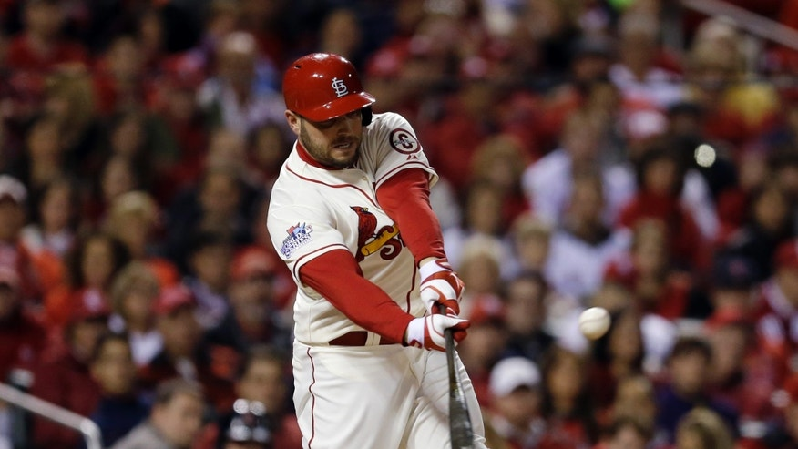 St. Louis Cardinals' Matt Holliday hits an RBI single during the first inning of Game 3 of baseball's World Series against the Boston Red Sox Saturday, Oct. 26, 2013, in St. Louis. (AP Photo/Jeff Roberson)