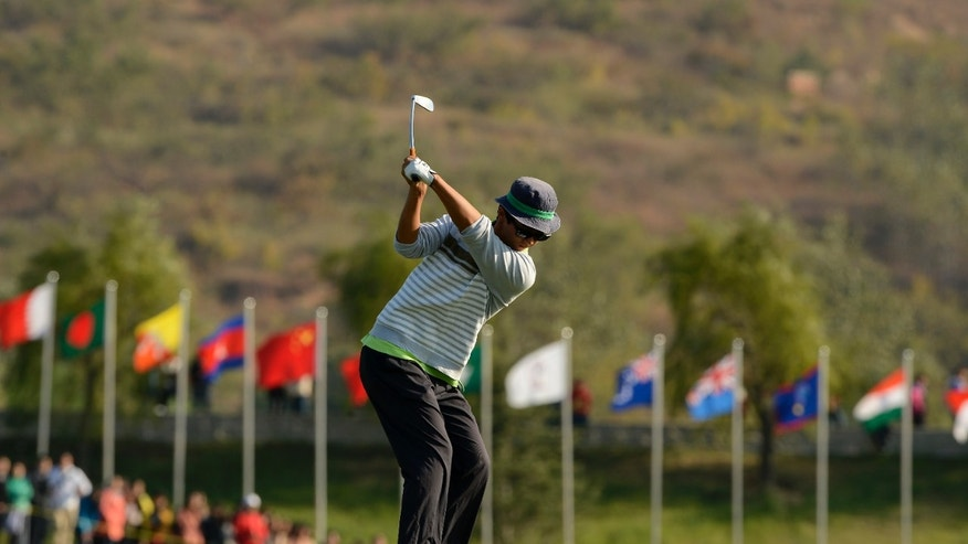Dou Zecheng of China swings to shoot his shot during the third round of the Asia-Pacific Amateur Championship golf tournament at Nanshan International Golf Club Garden Course in Longkou City, China Saturday, Oct. 26, 2013. (AP Photo/AAC, Paul Lakatos) NO LICENSING