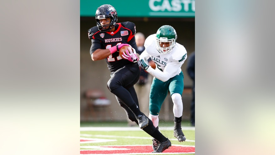 Northern Illinois wide receiver Juwan Brescacin (11) catches a touchdown pass in front of Eastern Michigan defensive back Ja'Ron Gillespie (21) during the first half of an NCAA college football game on Saturday, Oct. 26, 2013, in DeKalb, Ill. (AP Photo/Jeff Haynes)