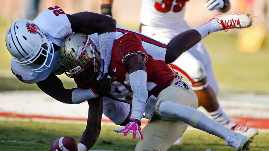 North Carolina State safety Hakim Jones (20) prevents Florida State wide receiver Kenny Shaw (81) from catching a pass in the second quarter of an NCAA college football game on Saturday, Oct. 26, 2013, in Tallahassee, Fla. (AP Photo/Phil Sears)